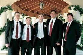 Groom In Black Tuxedo And Tie Groomsmen Tuxedos Red Ties