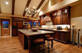 Italian Kitchen With Dark Wood Cabinets And Rustic Metal Chandelier