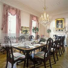 DINING ROOMS Queen Anne Chairs Long Mahogany Dining Table Set For Dinner With Crystal Floral Centerpiece Chandelier Formal Pale Pink Walls