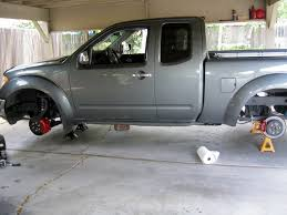 Jack Stand Recommendations? - Nissan Frontier Forum How To Replace Wheel Bearings Gmc Envoy Built To Drive Where To Use Jack And Stands 2005 Cadillac Cts Youtube Howto Front Bearing Hubs Rangerforums The Experiences With My Car Change Brake Pads Rotors On 2017 Nissan Titan Crew Cab Pickup Truck Review Price Horsepower Wkhorse Introduces An Electrick Pickup Truck Rival Tesla Wired Carbon Fiberloaded Sierra Denali Oneups Fords F150 Meet Macks 800hp Mega Crew Cab Top 25 Lifted Trucks Of Sema 2016 Hshot Trucking Pros Cons The Smalltruck Niche 3 Helpful Tips For Adjusting 4x4 Coilovers At Home Drivgline Jack Up A Big Safely Truck Edition