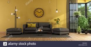 modernes wohnzimmer mit sofa und hocker gegen gelbe wand