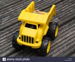 Yellow Plastic Toy Dump Truck With Load Of Sand Stock Photo ... New Arrival Pull Back Truck Model Car Excavator Alloy Metal Plastic Toy Truck Icon Outline Style Royalty Free Vector Pair Vintage Toys Cars 2 Old Vehicles Gay Tow Toy Icon Outline Style Stock Art More Images Colorful Plastic Trucks In The Grass To Symbolize Cstruction With Isolated On White Background Photo A Tonka Tin And Rv Camper 3 Rare Vintage 19670s Plastic Toy Trucks Zee Honk Kong Etc Fire Stock Image Image Of Cars Siren 1828111 American Fire Rideon Pedal Push Baby Day Moments Gigantic Dump
