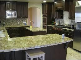 glass tile backsplash with granite countertops