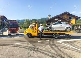 Ferrera Di Varese, Varese, Italy - June 26, 2018: Tow Truck ... Tow Truck Driver Cheats Death Dodges Skidding Car In Crazy Crash A Smashed Up Charter Bus Being Towed By A After Highway Blured Police Department Accident Stock Photo Royalty How To Get Paid Rates When Aaa Is Involved Company Towtruck Killed School Youtube Towing 131tow T Bone With Painful Extrication 62nd Pacific Milwaukee Service 4143762107 Hauling Away Passenger After Traffic Between Bike And Tow Truck Towing Accident Rollover Crash Remorquage Lapd Nicb Warn Of Bandit Scams