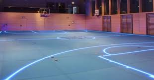 German Company Called ABS Systembau GMBH Ditches Those Painted Lines On Traditional Wooden Gym Floors And Replaces Them With Glowing Strips Of LED Light