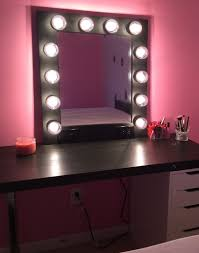 classic dressing room with purple bulb lights makeup mirrors