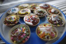 Sweden Stockholm Colorful Pastries On Blue Plate Stock Photo