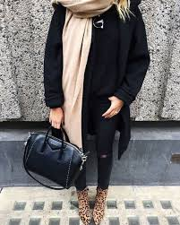 An All Black Outfit With A Camel Scarf And Leopard Print Boots