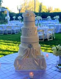 Beautiful white wedding cake with sugar orchids