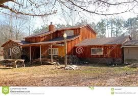 Ranch Style Home With Rustic Wood Siding
