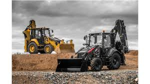 cat backhoe celebrate 30 years of backhoe loader production with caterpillar s