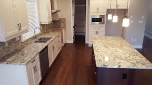 Updating 1980S Kitchen Cabinets Black Granite Countertops With Backsplash Ideas Brown Tiles Wooden Island Table Faucet Drip