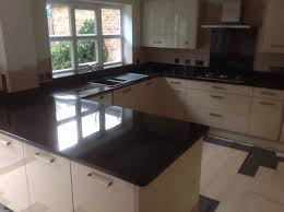 White Cabinets Dark Gray Countertops by Granite Countertop Kitchen Flooring Ideas With White Cabinets