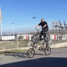 This Is A Man Riding Several Bikes At Once