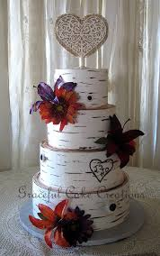 Rustic Birch Bark Wedding Cake With Purple And Orange Lilies Gerberas