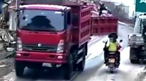Ouch! Truck's Tailgate Hits A Trio On A Motorbike