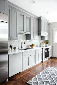 grey kitchen cabinets with glass backsplash light gray black