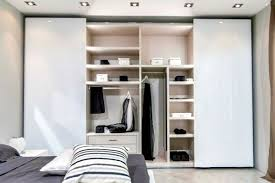 The modern wardrobe with sliding doors both practical and stylish