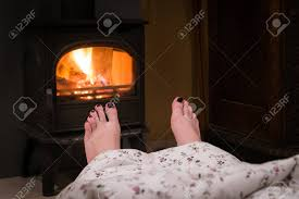 100 Foot Cozy Bare Woman Feet By The Fireplace Woman Relaxes By Warm Stock