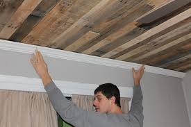 Diy Unfinished Basement Ceiling Ideas by Remodelaholic Rustic Pallet Wood Ceiling Tutorial