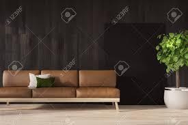 schwarzes wohnzimmer oder büro wartezimmerinnenraum mit einem browon ledersofa und einem eingemachten baum mock der wiedergabe 3d oben