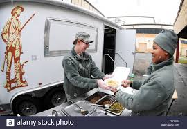 Senior Airman Megan Wulf, 113th Services Flight, Hands Food To A ...
