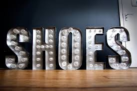 shoes illuminated fairground light bulb letters by goodwin