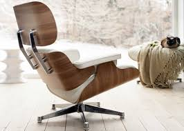 Tall Eames Lounge Chair & Ottoman In White-Pigmented Walnut & White Leather 12 Things You Didnt Know About The Eames Lounge Chair Why Are The Chairs So Darn Expensive Classic Chair Ottoman White With Black Base Our Public Bar Hifi Wigwam Vitra Walnut Black Pigmented Lounge Chair Armchairs From Architonic Version Pigmentation Nero 84 Cm Original Height 1956 Alinium Polished Sides Conran Shop X Departures Magazine