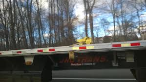 This 18-Wheeler Truck Carrying A Small Tonka Truck : Mildlyinteresting