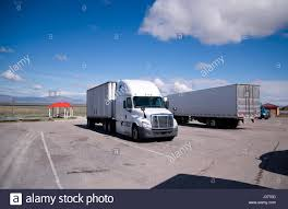 Improvised Small Truck Stop With A Few Semi Trucks Of Different ...