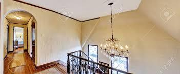 luxury house interior upstairs hallway with hardwood floor and