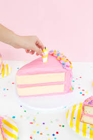 4 of your favorite cakes round Enough pink buttercream frosting to cover a 9″ cake Sharp knife Triangle template Piping bag