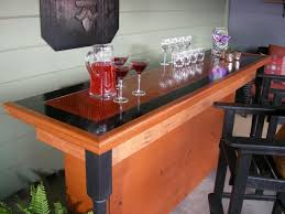 Build A Bar Using A Reclaimed Door For The Top | HGTV Bar Reclaimed Wood Rustic Countertop Awesome Bar Top Ideas 44 Homemade Top Wikiwebdircom Building A Counter Best Tops On Tables Homebrewing Diy Fishing A Beer Cap W Epoxy Keezer Lid Diy Alinum Foil Coffee Table Kelly Gene Decorating Polish Counter Making Pinterest Concrete On My Outdoor The Shack John Everson Dark Arts Blog Archive How To Build Your Hand Crafted Live Edge Walnut And Curved Reception Copper 2017 Creative Pictures Pinkaxcom