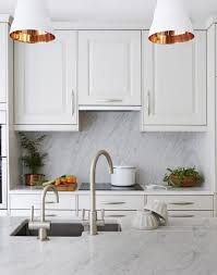 white traditional kitchen with copper lined pendant lights
