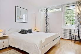 BedroomChic Scandinavian Bedroom Decor With White Bedsheet And Textured Wood Floor Also Glass Frame