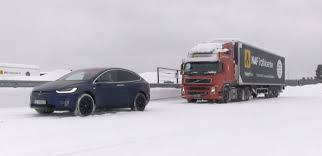 Watch A Tesla Model X Pull A 95,000-lb Semi Truck In The Snow | Electrek Tesla In Spotlight With Beast Electric Semitruck Elon Musk On The Electric Pickup Truck How About A Mini Semi Get Ready For Pickup And Heavyduty Truck Looks Like New Iepieleaks Vows To Build Right After Model Y Sued 2 Billion By Hydrogen Startup Over Alleged Leaked Image Of Spxmasterrace Plans Sell Trucks Big Semis Pickups Too Extremetech Just Received Its Largest Preorder Yet The Verge Teslas Said Companys Semi Will Reveals Roadster