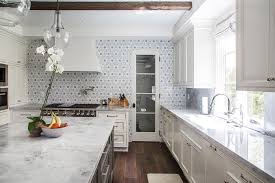 ivory kitchen cabinets with gray flower mosaic tile backsplash