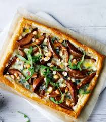 puff pastry canape ideas blue cheese pear and rocket puff pastry tart delicious magazine