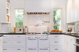 Example Of A Transitional Kitchen Design In Los Angeles With Recessed Panel Cabinets White