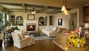Amusing Triple Pendant Lamps Over Marble Top Home Bar As Well Beige Fabric Covers Sofa And Rustic Fireplace In Open Floor Traditional Living Rooms Ideas