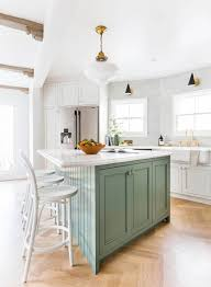 white kitchen ceiling with finishing beams sea green kitchen