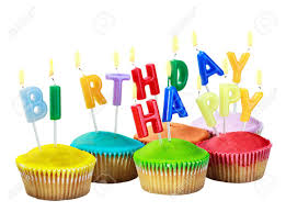 colorful happy birthday cupcakes with candles on white background Stock