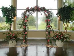 A Simple Garden Arch Can Be Covered In Flowers And Paired With Planters Topiary Trees Indoor Wedding ArchesIndoor