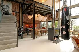 View In Gallery Industrial Loft With A Dashing Dining Room And Decor Design Zoevox