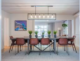 Eclectic Dining Room With Pendant Lights And Rectangular Table