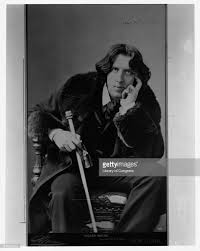 Oscar Wilde The Irish Writer And Literary Critic Sits For A Portrait During His