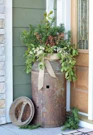 Old Rusty Milk Jug Turned Into A Planter Lovely Rustic Outdoor Decor For The Holidays