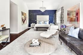 Eclectic Master Bedroom With Cathedral Ceiling Carpet Hardwood Floors Eames Lounge Chair