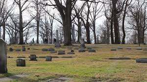 A Wooded Graveyard With People Strolling Through Stock Video Footage