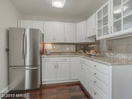 2x8 subway tile backsplash traditional kitchen with l shaped complex granite counters in